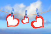 Three hearts drying on the rope — Stock Photo