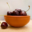 Stock Photo: Juicy cherry in bowl