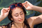 Young girl in red sunglasses — Stock Photo