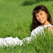Smiling girl on the meadow — Stok fotoğraf