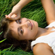 Young lady on the meadow — Stock Photo