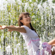 Pretty girl in the streams of the fountain — Stock Photo