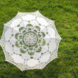 Beautiful sun umbrella on the green lawn — Stock Photo