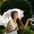 Emotional lady with white umbrella — Stock Photo #3871701