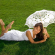 Stock Photo: Pretty lady relaxing on grass