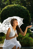 Emotional lady with white umbrella — Stock Photo