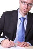 Businessman writes — Stock Photo