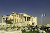 Erechtheum with Greek flag in Acropolis — Stock Photo