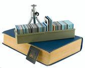 Book, tripod, box, slides — Stock Photo