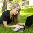 Girl on the nature of the laptop — Stock Photo #3552182