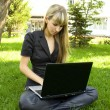 Girl on the nature of the laptop — Stock Photo #3552190