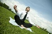 Businessman do yoga exercise outdoor — Stock Photo