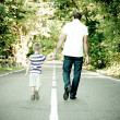 Father with his son go away hand to hand - Stock Photo