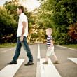 Father with his son cross crosswalk — Stock Photo