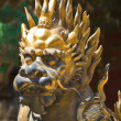 Bronze lion in China Emperor garden - Stock Photo