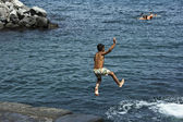 Child jumping in the sea — Stock Photo
