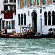 Venetian gondola and gondolier at the main canal of Venice. Ital — Stock Photo