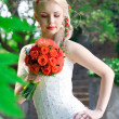 Stock Photo: Beautiful bride with wedding bouquet