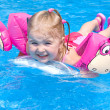 Happy small girl in a pool — Stock Photo