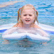 Stock Photo: Happy small girl in a pool