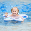 Happy small girl in a pool — Stock Photo #3440595