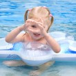 Happy small girl in a pool — Stock Photo #3440607