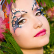 Beautiful woman with bright makeup outside - Stock Photo