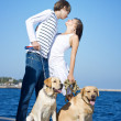 Young Couple Walking with Dogs — Stock Photo