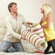 Royalty-Free Stock Photo: Young couple fighting with pillows