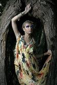 Young woman near tree — Stock Photo