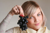 Female with grape — Stock Photo