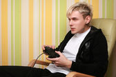 Excited young adult playing videogame — Stock Photo