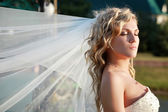 Bride with eyes closed — Stock Photo