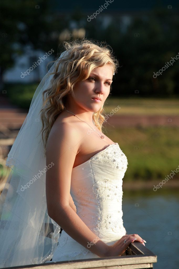Attractive caucasian bride posing on sunset  Stock Photo #3396352
