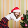 Girl near christmas tree — Stock Photo #3404481