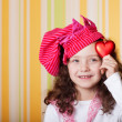 Girl with red heart — Stock Photo #3404839