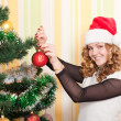 Teenager with christmas tree — Stock Photo #3405129