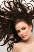 Beautiful woman with clean shiny hair — Stock Photo