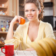 Pretty woman in the kitchen — Stock Photo