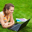 Girl on grass with laptop — Stock Photo