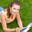 Girl with book on grass — Stock Photo #3594353