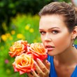 Woman in blue with roses - Stock Photo