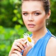 Pretty woman with flower in garden — Stock Photo #3628292