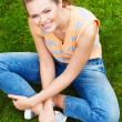 Woman sitting on grass — Stock Photo