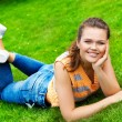 Pretty teen on green grass - Stock Photo