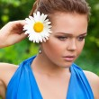 Pretty woman with camomile - Stock Photo