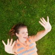 Pretty female on grass — Stock Photo