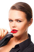Woman apply lipstick — Stock Photo