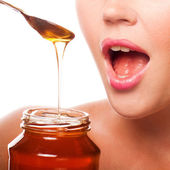 Woman with honey — Stock Photo