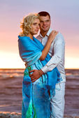 Attractive couple at sunset — Stock Photo